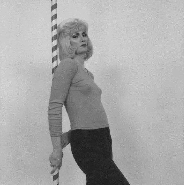 Jayne leaning against a pole for NME shoot