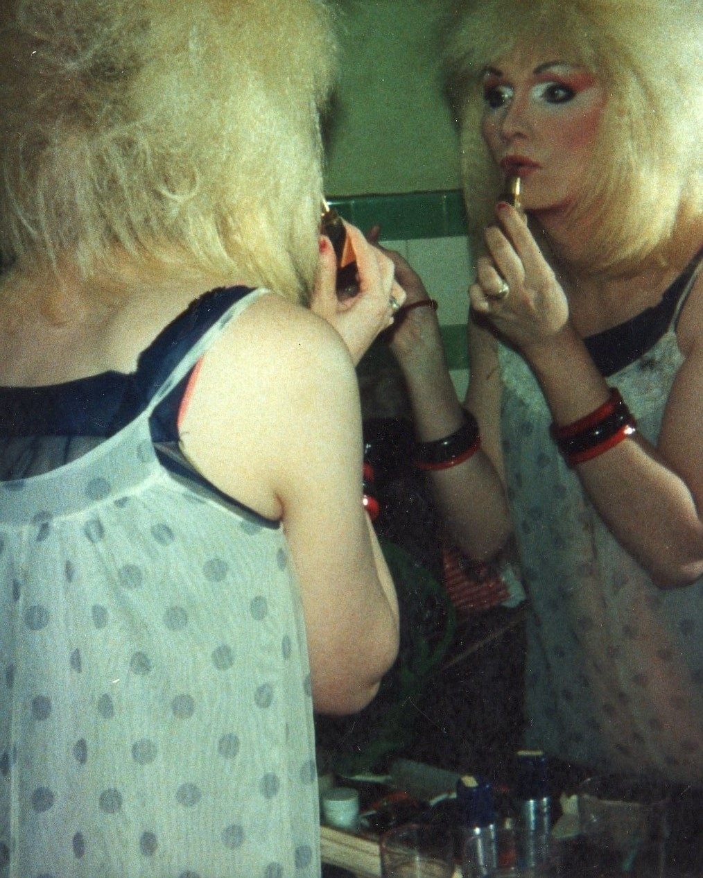 Jayne applying lipstick at The Pyramid Club 1988